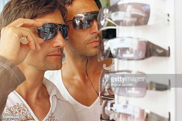 Two Men Trying On Sunglasses