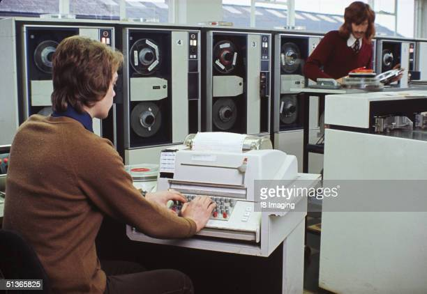 Two men using a mainframe computer in a laboratory circa 1975
