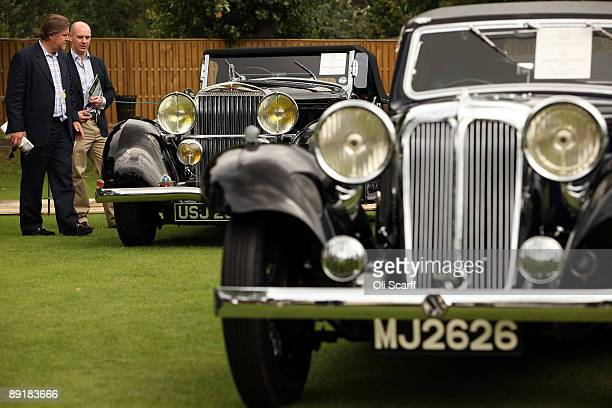 Two men view a 1933 Hispano Suiza J12 on display at the Salon Prive luxury and supercar event held at the Hurlingham Club on July 22 2009 in London...