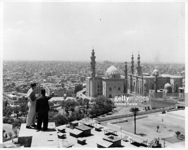 Two men view the MosqueMadrassa of Sultan Hassan in Cairo Egypt