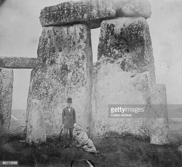 Two men visit the prehistoric site of Stonehenge in Wiltshire circa 1890