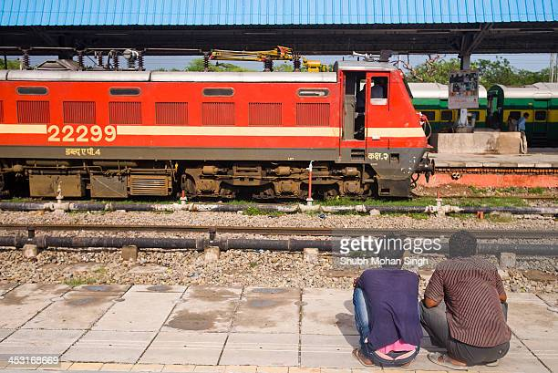 Two men waiting for their train in Chandigarh Railway Station.