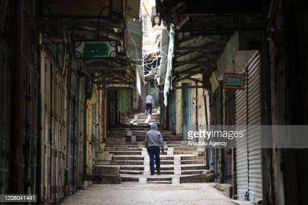 Two men walk in an empty street at Old Town, where shops were closed, after preventive measures against the coronavirus pandemic are taken in...