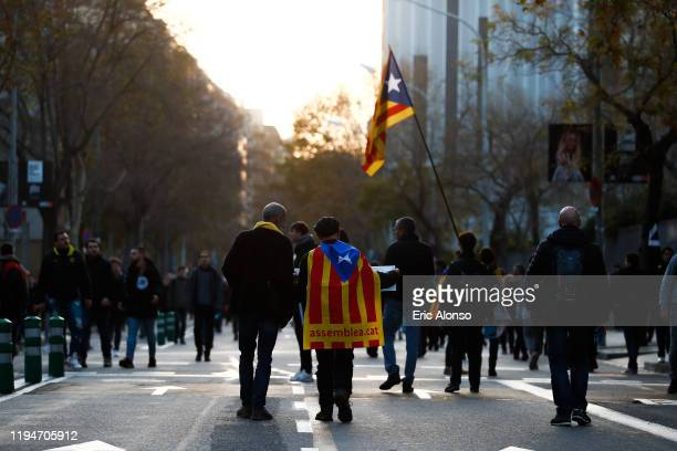 Two men walk with the independence flag of Catalonia before the Liga match between FC Barcelona and Real Madrid CF at Camp Nou on December 18, 2019...