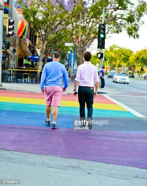Two men walking on a rainbow crosswalk, West Hollywood