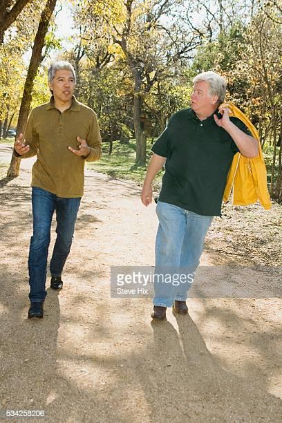 Two Men Walking Side by Side