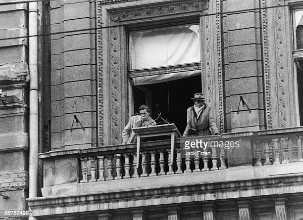 Two men watching from a balcony during the antiCommunist uprising in Hungary 12th November 1956