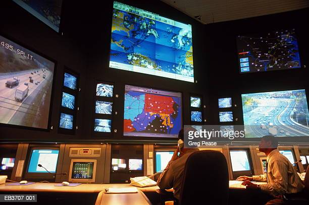 Two men watching monitors in Highway operations centre