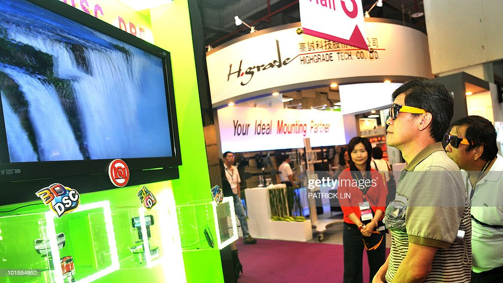 Two men wear goggles as they look at 3D images at a booth of the Taipei World Trade Centre, where Computex Taipei, Asia's biggest information technology trade fair is being staged on June 2, 2010. More than 1,700 exhibitors are taking part in the five-day trade show, featuring 4,861 booths and expected to greet around 120,000 visitors, including 35,000 international buyers, organisers say. They expect the fair to generate around 20 billion US dollars in business.