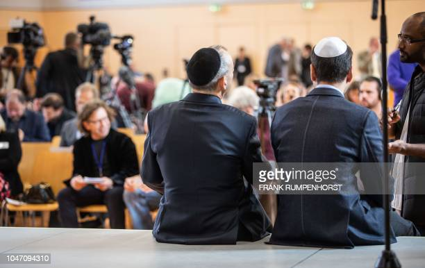 Two men wear Jewish kippa skullcaps as they attend a founding event for a new Jewish grouping within Germany's farright AfD party on October 7 2018...