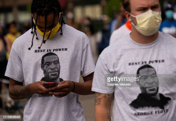 Two men wear shirts stating Rest in Power George Floyd outside the Third Police Precinct on May 27 2020 in Minneapolis Minnesota The station has...