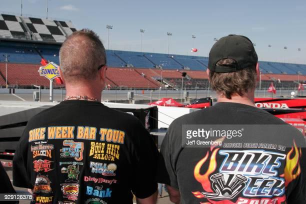 Two men wearing bike week tee shirts in the Fan Zone on the International Speedway at Daytona Beach