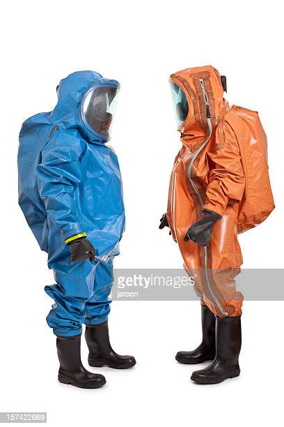 two men wearing chemical protection suit - hazmat stock pictures, royalty-free photos & images