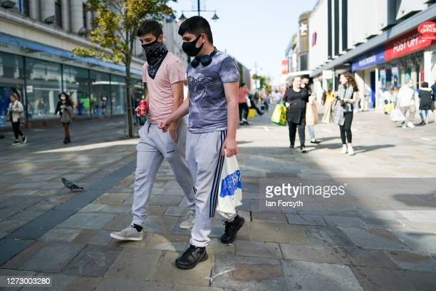 Two men wearing face masks walk with bags of shopping through Newcaslte city centre on September 17 2020 in Newcastle upon Tyne England Almost two...