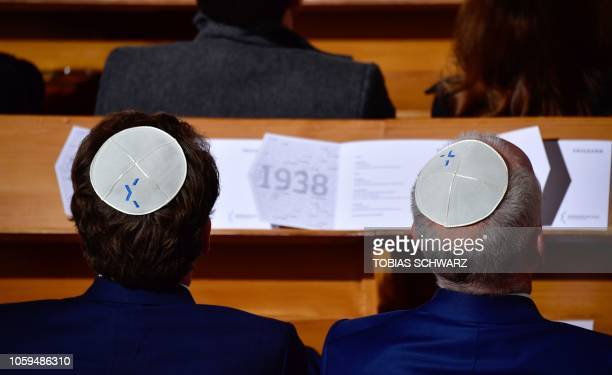 Two men wearing Jewish kippa skullcaps attend a ceremony at the Synagogue Rykestrasse in Berlin on November 9 2018 to commemorate the 80th...