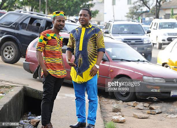 Two men wearing typical African clothes speak together in a street of Monrovia on September 6 2016 After almost 200 years of Western influence on...