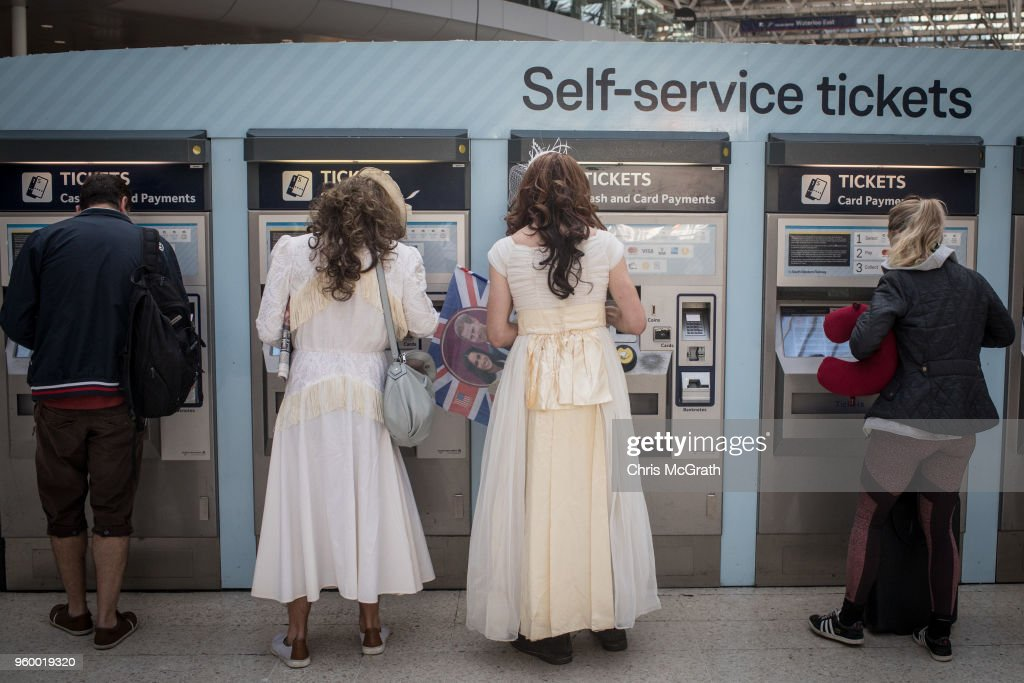 Two men wearing wedding dresses buy train tickets to Windsor to watch the Royal Wedding of Prince Harry and Meghan Markle at Waterloo train station on May 19, 2018 in London, England. The marriage of Britain's Prince Harry and US actress Meghan Markle is being held in Windsor today at the St George's Chapel in Windsor Castle.