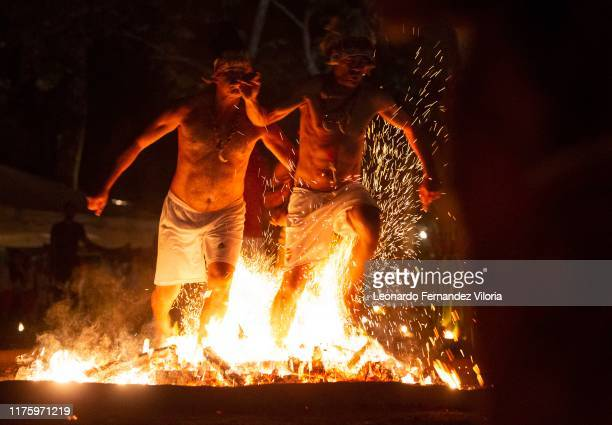 Two men who are in a trance for the spirits of Indian warriors called Caciques they step on the burning flames with bare feet in honor of these...