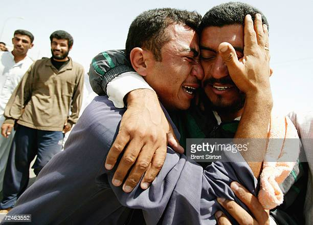 Two men who are overcome with emotion after being released from Abu Ghraib prison hug May 14 2004 in the city of Baquba outside of Baghdad Iraq One...