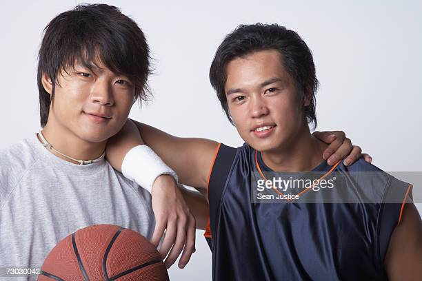 Two men with a basketball, portrait
