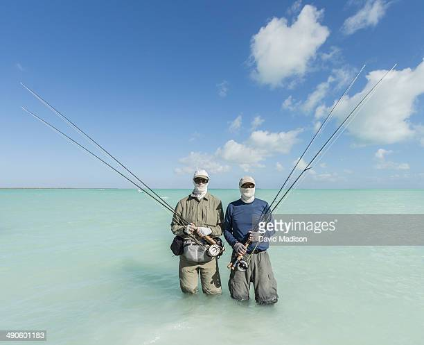 Two men with bonefishing gear, Christmas Island.