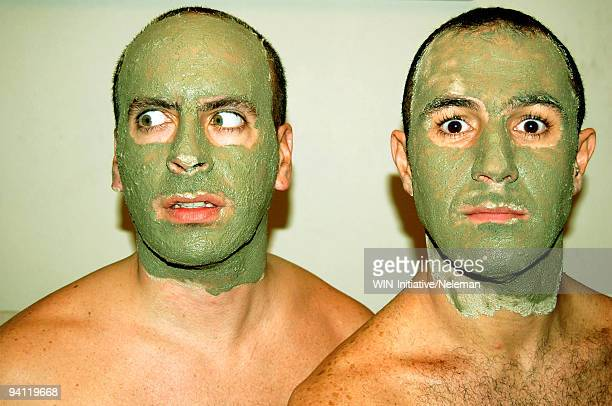 Two men with mud masks, Santiago, Chile