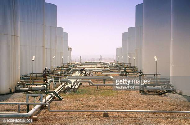 two men working at oil storage tank - nigeria stock pictures, royalty-free photos & images