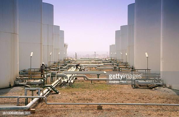 Two men working at oil storage tank