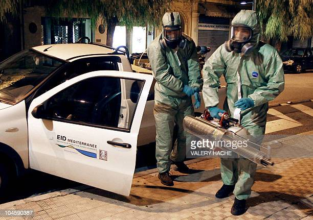 Two men working for the French interdepartmental alliance for mosquito control on the Mediterranean coast EID Mediterranee prepare before an...