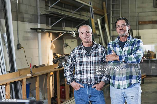 Two men working in factory warehouse