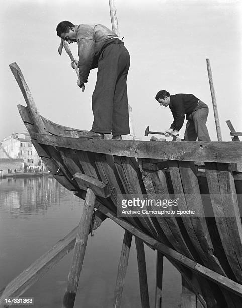 Two men working on a sail boat frame Chioggia Venice 1950