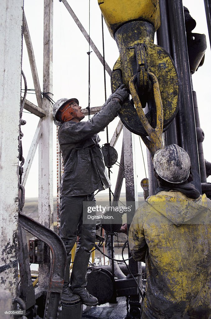 Two Men Working on an Oil Rig : Stock Photo