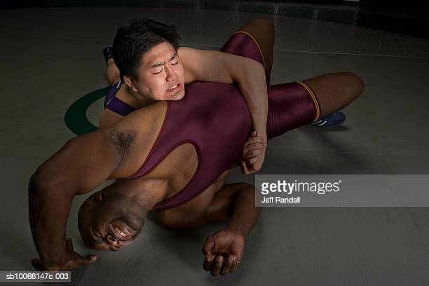two men wrestling, elevated view - mixed wrestling stock pictures, royalty-free photos & images