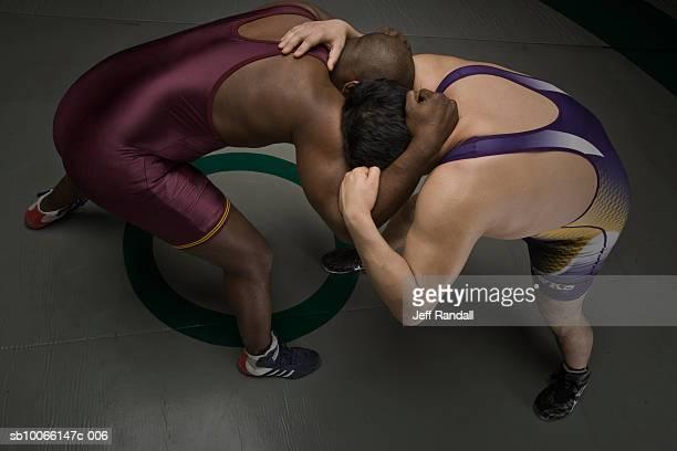 two men wrestling, elevated view - レスリング ストックフォトと画像