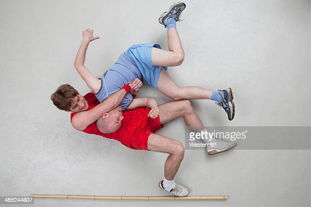 two men wrestling - wrestling stock pictures, royalty-free photos & images