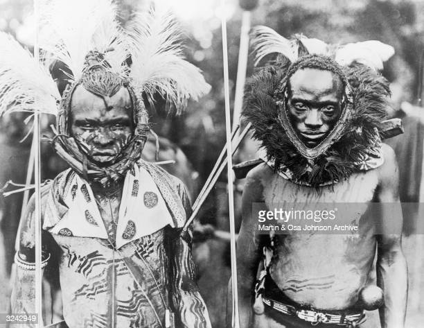Two Meru warriors wear ceremonial headdress and body paint Africa Photographed by husband and wife explorers Martin and Osa Johnson