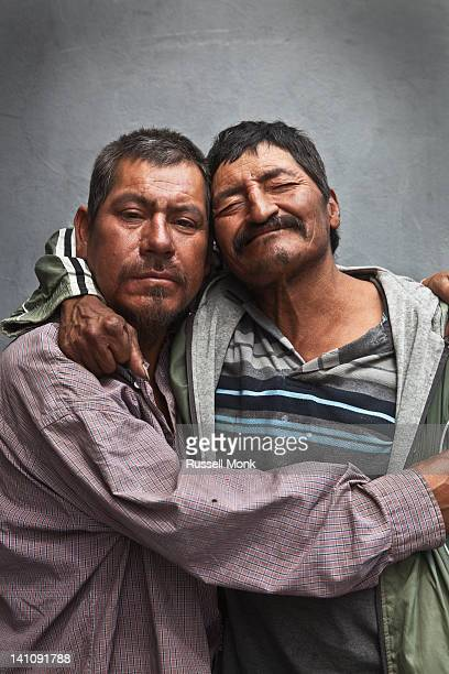 two mexican drunk men holding each other. - drunk mexican stock pictures, royalty-free photos & images