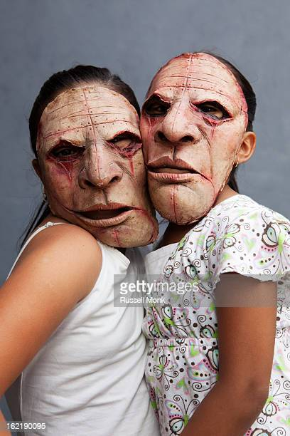 two mexican girls wearing bizarre masks. - ugly girl stock photos and pictures