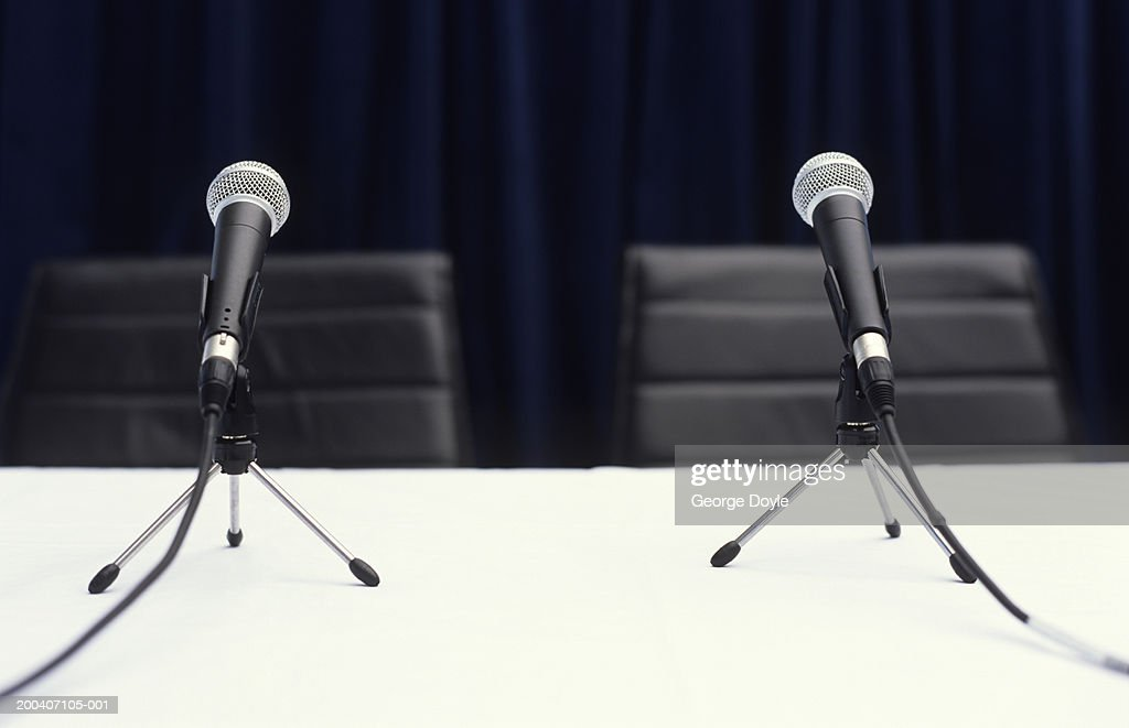 Two microphones on table, close up : Stock Photo