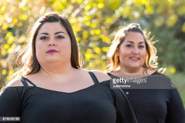 two mid adult women - arab women fat stock pictures, royalty-free photos & images