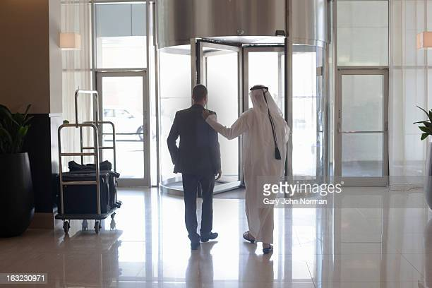 Two Middle Eastern Businessmen leaving hotel