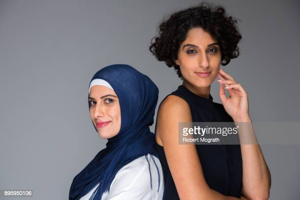 Two Middle Eastern women dressed in alternative clothing options