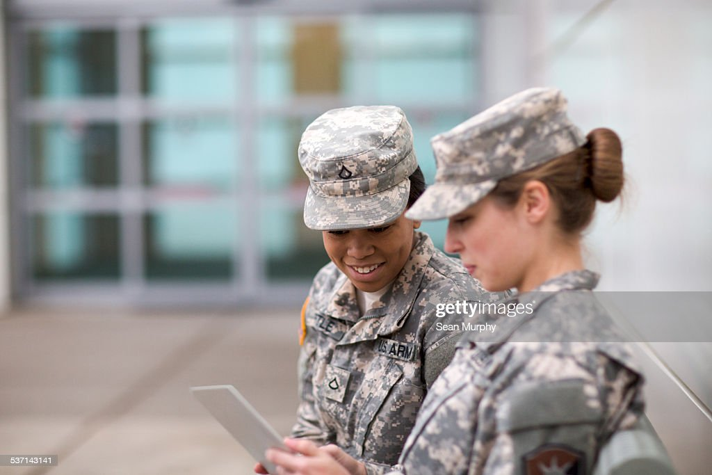 Two Military Girls Looking at Tablet : Stock Photo