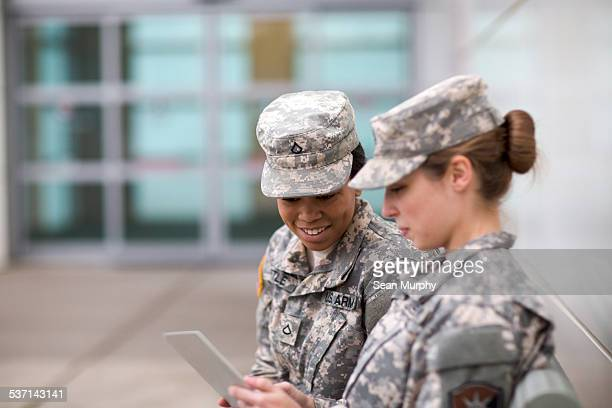 two military girls looking at tablet - military training stock pictures, royalty-free photos & images