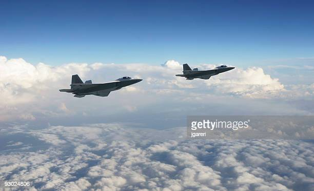 Two military jets above the clouds