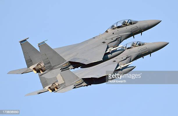 Two military jets against a blue sky