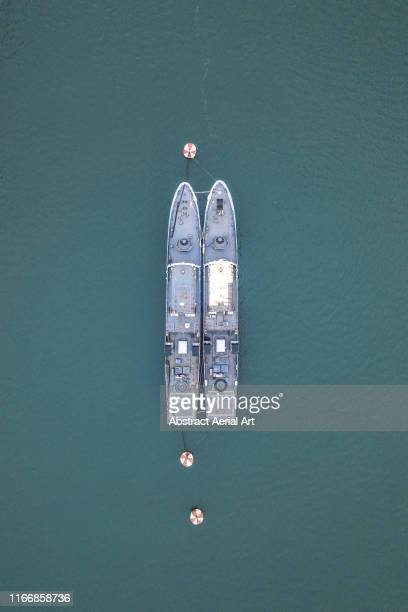 two military ships in the naval graveyard of landévennec as seen from above, brittany, france - warship stock pictures, royalty-free photos & images