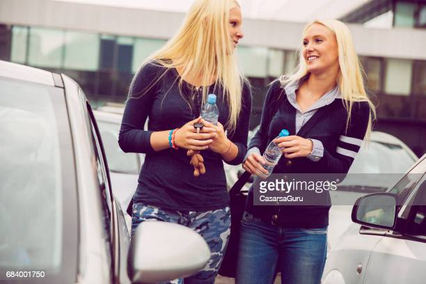 Two Millennials Young Woman Searching For The Car In The Parking