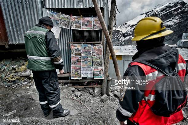 Two miners reading the press of the day At more than 5000 meters of altitude resisting the cold and lack of oxygen about 70000 people survive chasing...