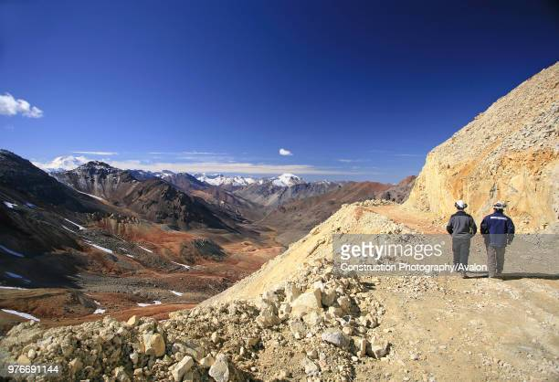 Two Miners Walk Through The Exploration Road In The Andes At 4000 m High They have The Best View To Argentina